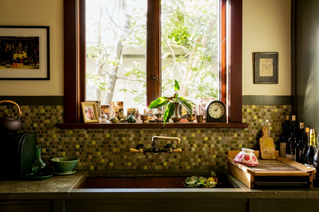 """A view of the kitchen sink in Alice Water's own kitchen. She says """"I think it's important to have a big sink."""""""